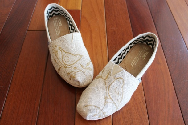 Gold burlap metallic TOMS painted with bronze colors birds on branches, by artist Lauren Rundquist at LaQuist.