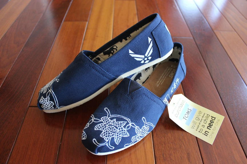 Custom painted lace TOMS shoes to match a bride's wedding gown by artist Lauren Rundquist at LaQuist.