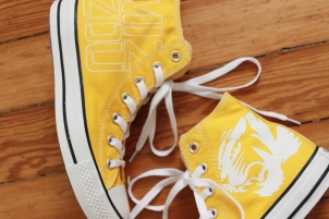 A pair of custom Mizzou Tigers converse high tops hand by artist Lauren Rundquist at LaQuist.