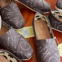 A pair of custom algebra TOMS hand painted by artist Lauren Rundquist at LaQuist.
