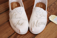 """A hand painted pair of """"Just Married"""" bridal wedding TOMS by artist Lauren Rundquist at LaQuist."""