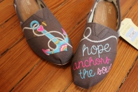 """A hand painted pair of nautical anchor TOMS shoes with the quote """"Hope anchors the soul"""" by artist Lauren Rundquist at LaQuist."""