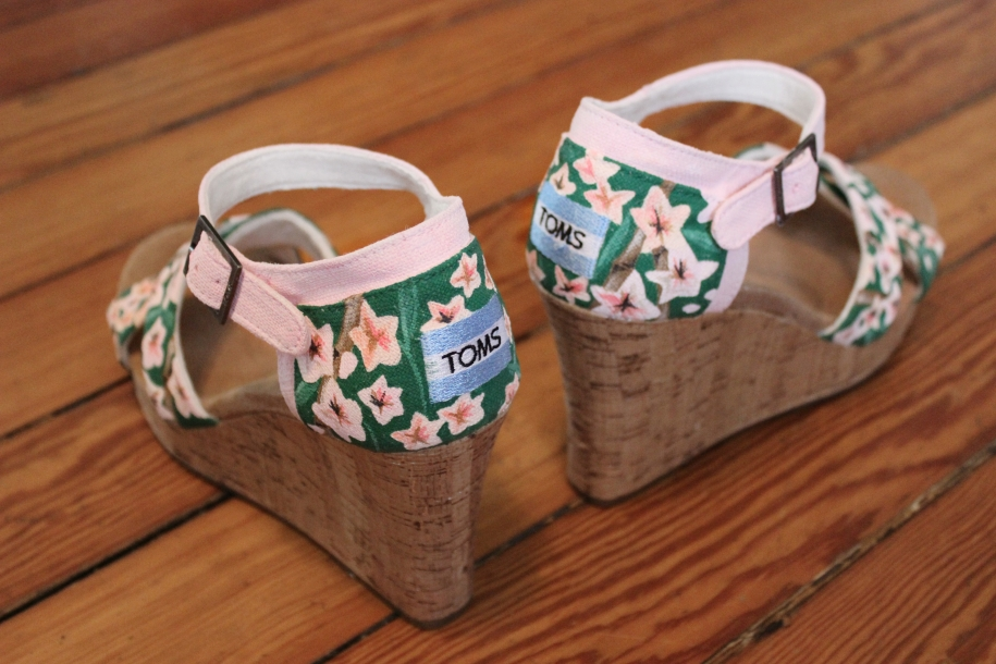 A hand painted pair of cherry blossom and bamboo TOMS wedges by artist Lauren Rundquist at LaQuist.