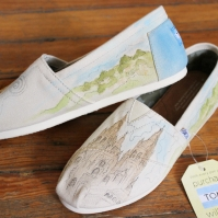 A hand painted pair of Spanish inspired custom TOMS shoes by artist Lauren Rundquist at LaQuist.