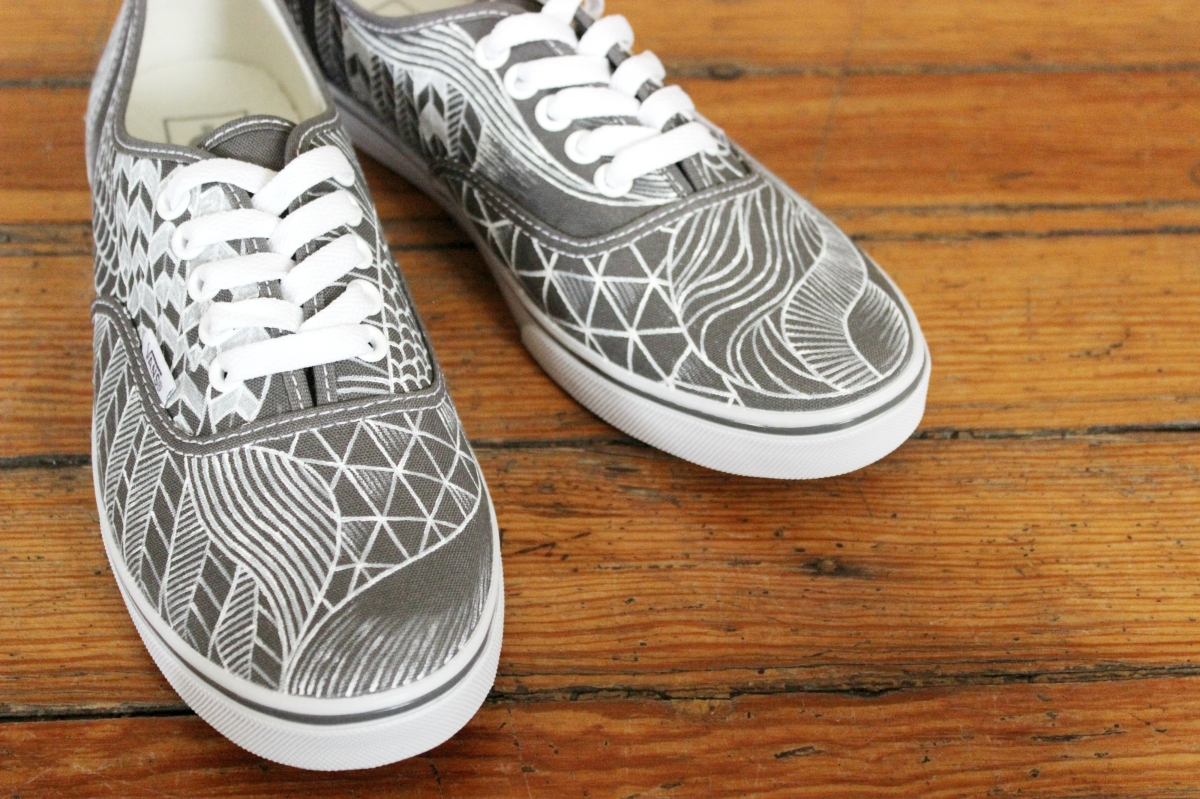 A hand painted pair of custom modern pattern Vans shoes by artist Lauren Rundquist at LaQuist.