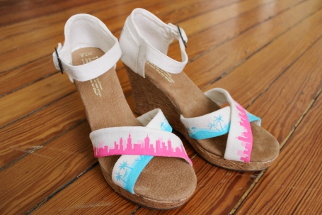 Custom hand painted TOMS wedges with a city skyline and a beach skyline by artist Lauren Rundquist at LaQuist.