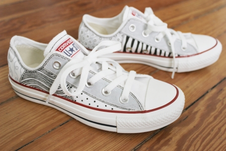 A custom hand-painted pair of Converse by artist Lauren Rundquist at LaQuist.