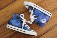 A pair of custom galaxy Converse high tops hand painted with stars and constellations by artist Lauren Rundquist at LaQuist.
