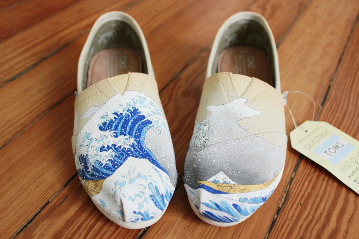 A pair of custom TOMS hand painted with The Great Wave off Kanagawa by artist Lauren Rundquist at LaQuist.