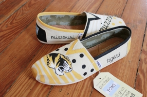 A pair of custom Mizzou Tigers TOMS hand by artist Lauren Rundquist at LaQuist.