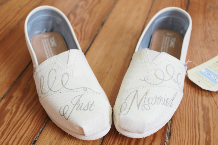 "A hand painted pair of ""Just Married"" bridal wedding TOMS by artist Lauren Rundquist at LaQuist."