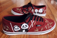 A pair of custom Vans hand painted with pandas and bamboo by artist Lauren Rundquist at LaQuist.