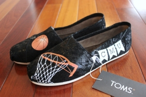 A pair of custom basketball TOMS hand painted by artist Lauren Rundquist at LaQuist.