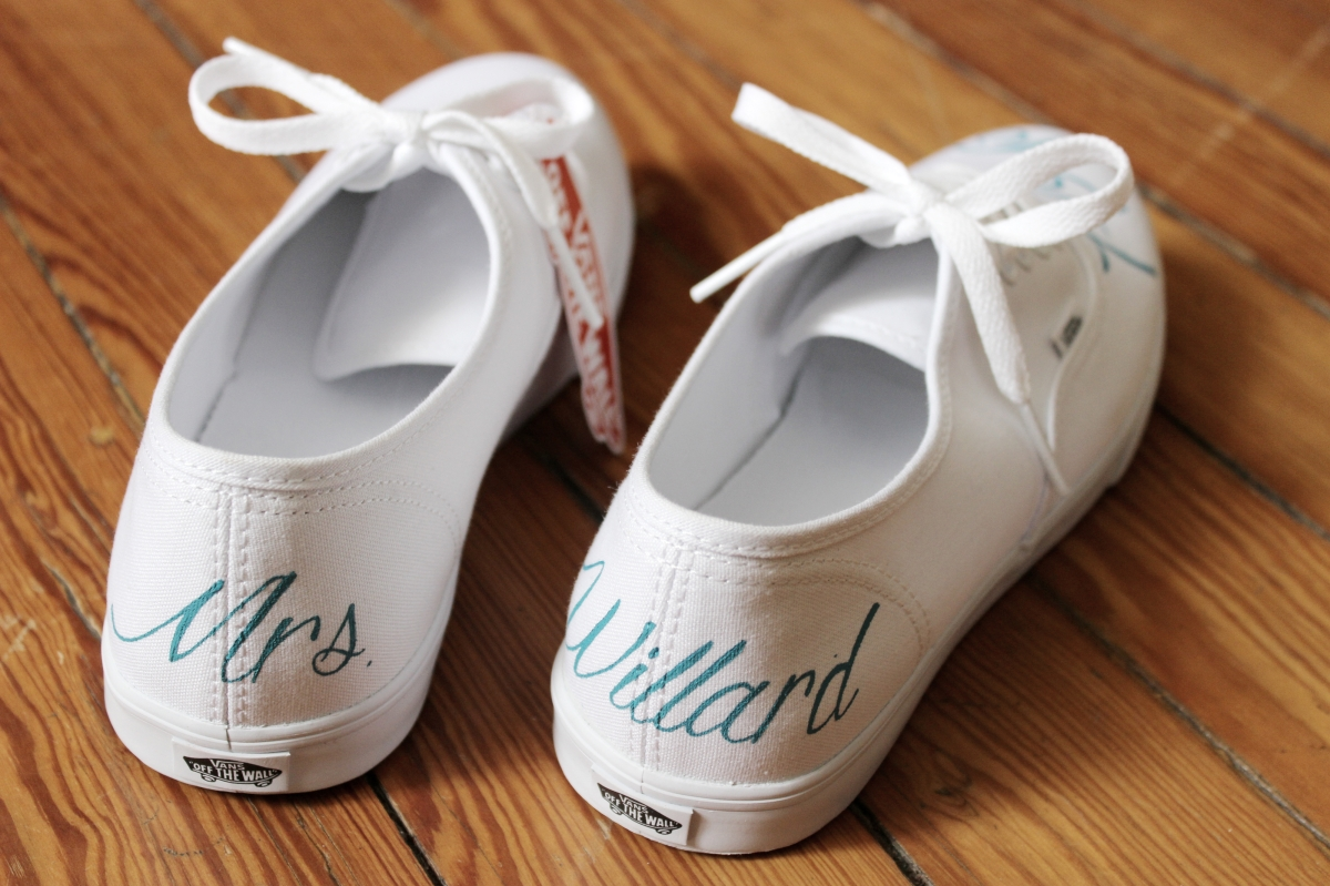A pair of custom bridal Vans hand painted by artist Lauren Rundquist at LaQuist.