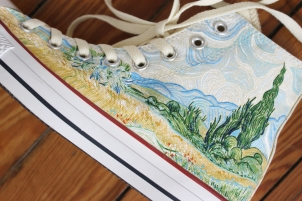 A pair of Vincent Van Gogh Starry Night and Cypresses high top Converse shoes hand painted by artist Lauren Rundquist at LaQuist.