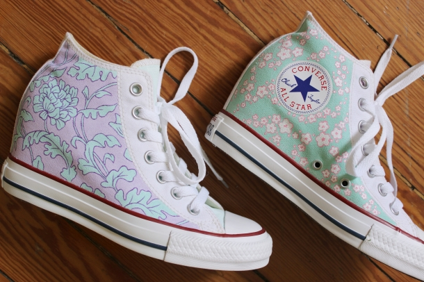 A pair of floral wedding high top Converse shoes hand painted by artist Lauren Rundquist at LaQuist.