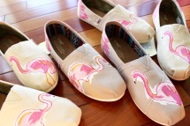 A pair of custom pink flamingo TOMS hand painted by artist Lauren Rundquist at LaQuist.